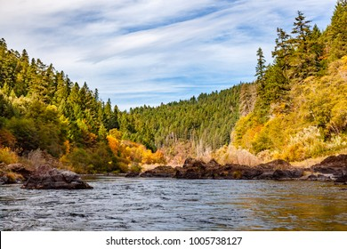 Fall colors of orange and yellow on the Rogue River with a perfe