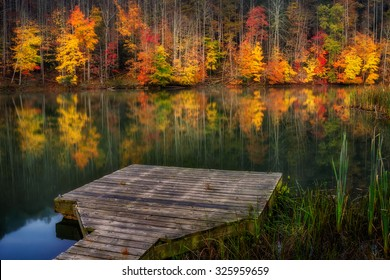 Fall colors reflect on the calm waters of Cranks Creek Lake in Southeastern Kentucky.