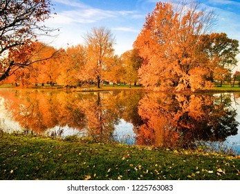 Fall colors reflect on a pond