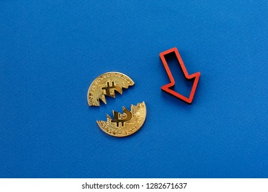 Fall in the cost of bitcoin. Concept of a cryptocurrency market crisis. Blockchain technology. Bitcoin and red arrow down.