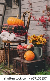 fall at country house. Seasonal decorations with pumpkins, fresh apples and flowers. Autumn harvest at farm.