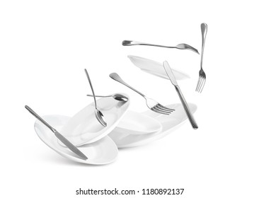 Fall of dishes and cutlery isolated on white background