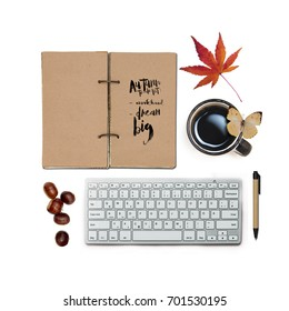 """Fall elements isolated: maple leaf, coffee cup, butterfly, chestnuts and  back to school supplies: pen, keyboard and open notebook with quote about future """"Autumn to-do list: work hard, dream big""""."""