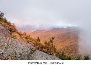 Fall foliage on mountain with clouds