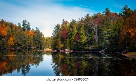 Fall foliage reflected in the Franklin Falls Pond in Franklin, New York, the Adirondacks