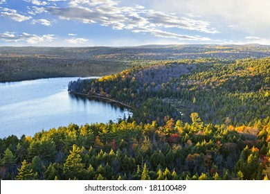 Fall forest and lake with colorful trees from above in Algonquin Park, Canada
