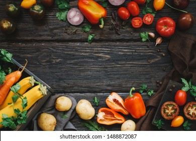 Fall harvest of organic vegetables. Rustic table background, top view, frame.