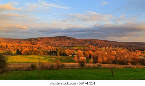 Fall in Hudson Valley NY. Leaves changing color with overcast sky. Near Troy NY.