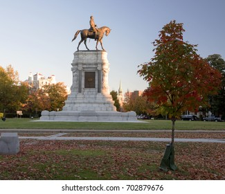 Fall leaves surround the statue of Robert E Lee.