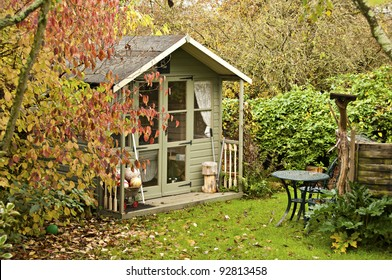 Fall leaves surround the summerhouse at the bottom of the garden