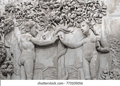 The Fall of Man  (Eden narrative) - Adam and Eve  take fruits from a  Tree of life  in  Garden of Eden - relief on an external facade of  Cathedral  Orvieto (Duomo),  Umbria, Italy