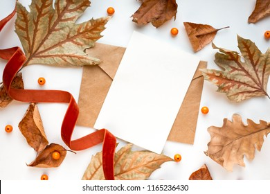 fall mockup card with autumn leaves invitation card with environment and details Mockup with postcard and flowers and ribbon on white background.