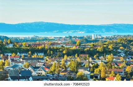 Fall in the norwegian city Trondheim. The view of the Trondheim fjord, historical center and residential district .