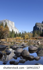 Fall on the Merced River, Yosemite National Park, reflection of El Capitan in background, perfect blue sky day.