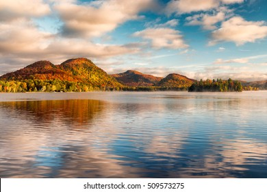 Fall reflection at sunrise in Lac Superieur, Quebec, Canada