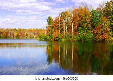 Fall reflections in the ripples on the water in Beaverdam reservoir in Gloucester county, southeastern tidewater Virginia.