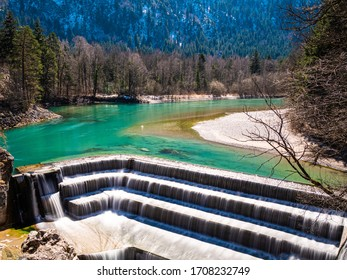 The fall of the river Lech close to the city of Fuessen during spring with turquoise water