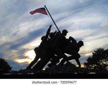 Fall River, Massachusetts - October 13, 2013: A replica of the Marine Corps War II Memorial. Iwo Jima monument in Veterans Bicentennial Park on the waterfront of Fall River, Massachusetts at sunset.