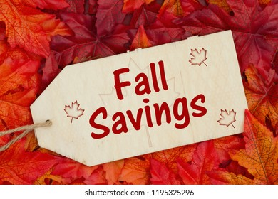 Fall Savings message, Some fall leaves and a wood gift tag with text Fall Savings