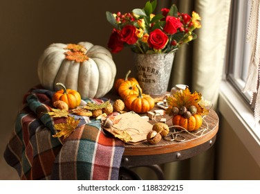 Fall seasonal decorations with pumpkins, fresh acorn, chestnuts and flowers. Autumn harvest at farm at country house, gift card for birthday preparation