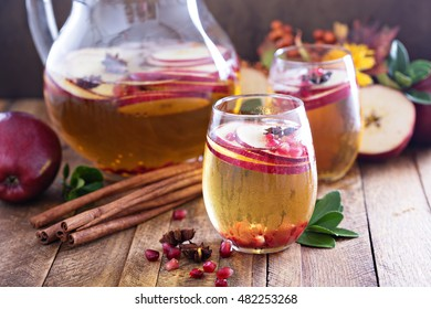 Fall sparkling drink with apple cider, spices and pomegranate