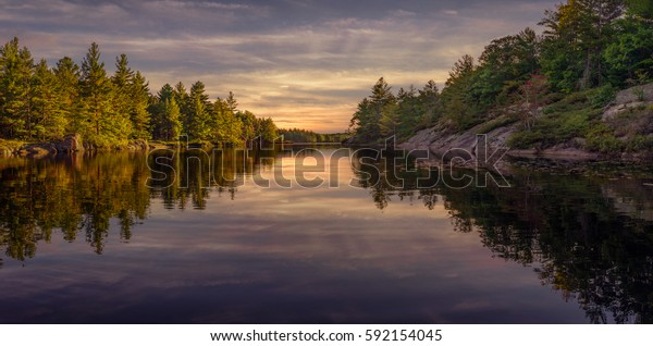 Fall Sunset at the Kawartha Highlands Provincial Park Bass fishing from a canoe on Wolf lake, Ontario, Canada
