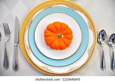 A Fall or Thanksgiving table setting.