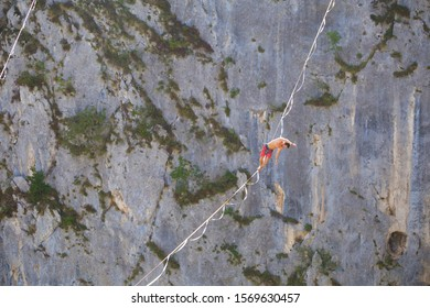 The fall of the tightrope walker. Highliner hanging on a sling. A man catches a balance on a stretched rope. Safety in the Highline.