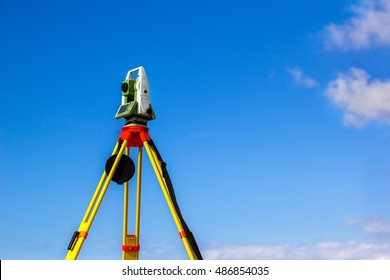 Fall time land surveying, total station set in the field