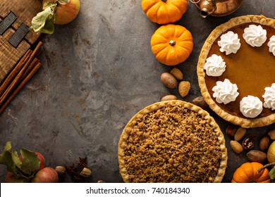 Fall traditional pies pumpkin, pecan and apple crumble pie overhead shot with copy space