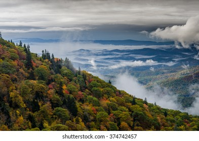 Fall view of early morning clouds between mountain ridges along the Blue Ridge Parkway
