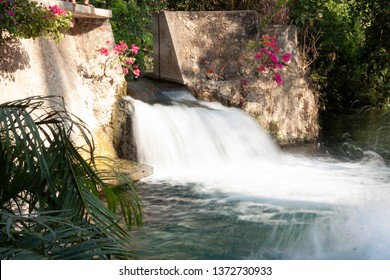 Fall of water in natural river stakes Morelos Mexico water falls towards the depth of the turquoise river place for relaxation