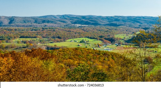 Fall in a West Virginia valley. Scene is set in Appalachian mountains with a little community in the hollow.