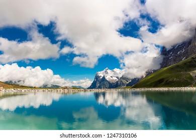 Fallbodensee (man-made lake) at the Jungfrau Eiger Walk in the Swiss mountains, Grindelwald, Bernese Oberland, Switzerland