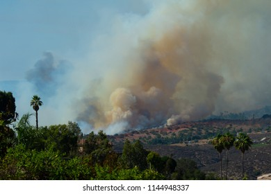 Fallbrook, California, USA – July 29 2018: CalFire battles wildfire as smoke rises near Fallbrook, California in San Diego County.