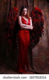Fallen angel. Attractive sensual woman angel wings. Innocent pure girl. Femininity and sensuality. Angel feather wings accessory. Provoke sexual desire. Divine lovers. Impeccable body. Sexy cupid