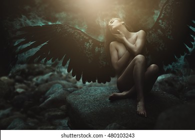Fallen angel with black wings . Dark fantasy manipulation