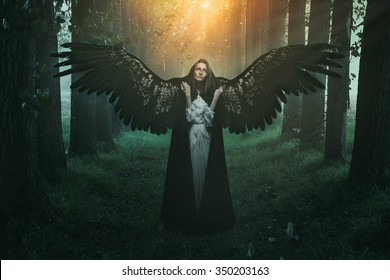 Fallen angel with sad expression and eyes to the sky