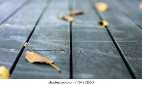 Fallen Autumn leaves on wooden decking