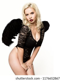 fallen black angel with wings. Sexual woman in black bodysuit and black wings on a white background. free space for your text