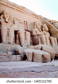 The fallen Pharaoh's head on the ground before the Great Temple, Abu Simbel in Egyptian, in Nubia village in Egypt. The complex is part of theUNESCOWorld Heritage Siteknown as the Nubian Monuments.