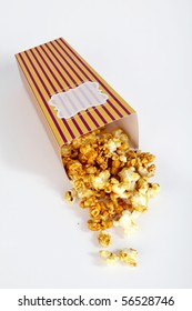 fallen popcorn box with popcorn - top angle