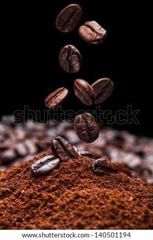 Falling brown roasted coffee beans