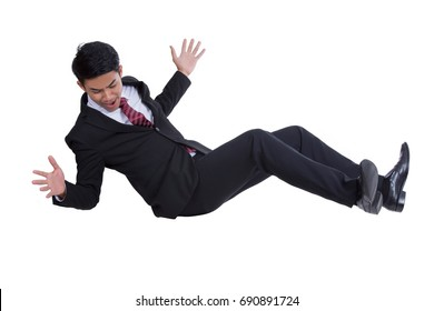 Falling businessman isolated on the white background.