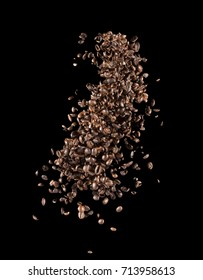 falling coffee beans on a black background