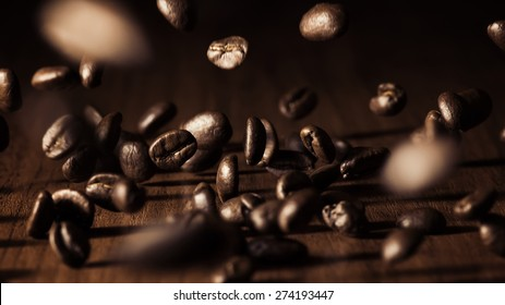 Falling coffee beans on a wooden table