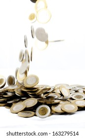 falling coins on isolated background