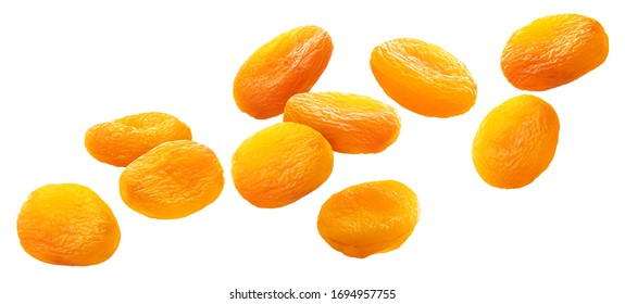 Falling dried apricots isolated on white background with clipping path