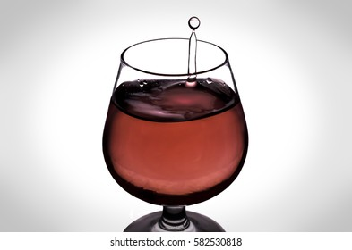 Falling drops of water into the wine glass