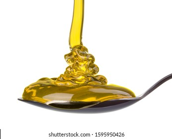 Falling and flowing honey on a spoon isolated on white background with clipping path.